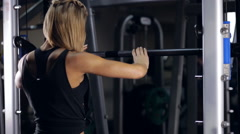 Sexy girl squat in smith machine Stock Footage