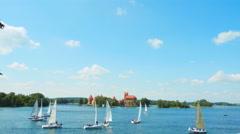 Regatta on the lake near Trakai Castle, Lithuania - stock footage