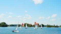 Regatta on the lake near Trakai Castle, Lithuania Stock Footage