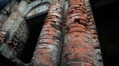 Tilt up shot of  pillars of old building. Stock Footage
