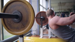 Athletic man. Chest workout with barbell - stock footage