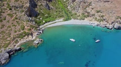 Aerial view of mountain landscape with secluded beach Stock Footage