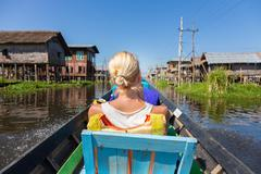 Female tourist travels by traditional boat. - stock photo