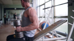 Athletic man doing chest workout with dumbbells - stock footage