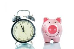 Alarmclock with piggybank on white background Stock Photos