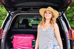 Vacation, Travel concept - young woman ready for the journey on summer holidays - stock photo