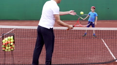 Tennis training on a clay court Stock Footage