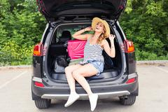 Vacation, Travel concept - young woman ready for the journey on summer holidays Stock Photos