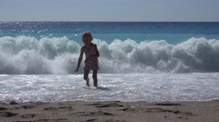 4K Young Girl Running in Waves, Beach View, Child, Kid Walking on Seashore Stock Footage