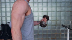 Athletic man. Biceps with dumbbells - stock footage