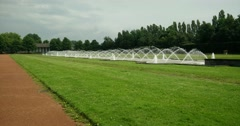 Long field with a large fountain in a park Stock Footage