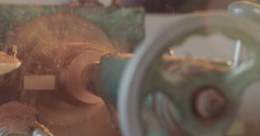Wooden cylinder on a lathe - stock footage