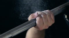 Male Hand Grabs The Barbell. Powder Magnesia. Slow-Mo Stock Footage