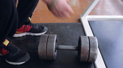 Using hand straps with dumbbell Stock Footage