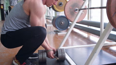 Spine workout with dumbbell - stock footage