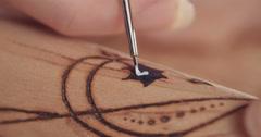 Artist painting on buddhist prayer wheel Stock Footage