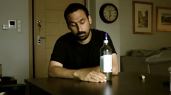 A man with a drinking problem. - stock footage
