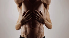 Woman love man's abs. White background - stock footage