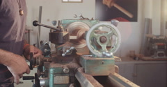 Man using lathe to work on wood art Stock Footage