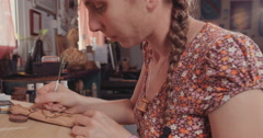 Artist creating wood artwork Stock Footage
