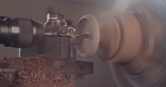 Work on a wood art piece using a lathe Stock Footage