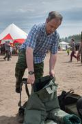 Man - visitor of show tries on the sapper suit Stock Photos