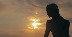 Statue of Little Mermaid at golden sunset Stock Footage
