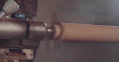4K lathe work on a wooden cylinder in slow motion - stock footage