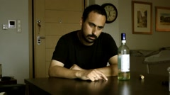 A man with a drinking problem (laugh and cry). - stock footage
