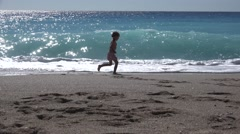 4K Young Girl Running in Waves, Beach View, Child, Kid Walking on Seashore - stock footage