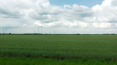 Power transmission line. Electric lines in the green field. Stock Footage