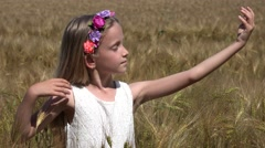 4K Girl Praying to Rain in Wheat Field, Pensive Prayer Child Meditating, Nature - stock footage