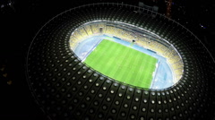 Professional players running at football pitch, night time match, sports game Arkistovideo