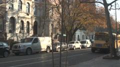 School Bus in Quiet New York Neighbourhood Stock Footage