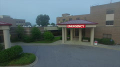 Aerial Over Hospital Emergency Room At Dawn Stock Footage
