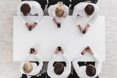 Business people with cell phones - stock photo