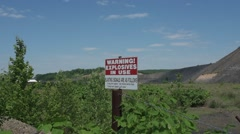 Blasting Sign at Strip Mine Stock Footage