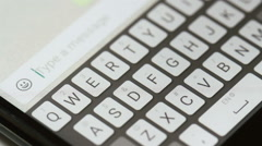 Typing message on mobile phone Stock Footage