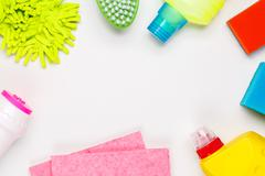 House cleaning products on white table Stock Photos