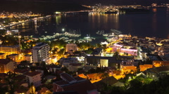 Budva city coastline with walled old town and marina. Timelapse view at night Stock Footage