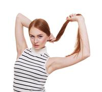 Redhead woman with strong healthy hair portrait - stock photo