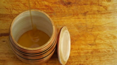 Footage barrel of honey on a wooden table close-up Stock Footage