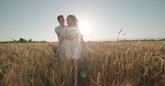 Young loving carefree couple wheat field outdoors sunset silhouette happy - stock footage