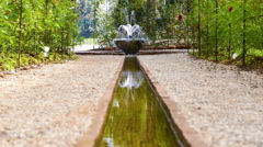 Artificial waterfall in botanic garden Stock Footage