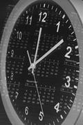 Clock face and calendar page Stock Photos