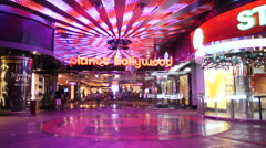 Zoom Out - Entrance to Planet Hollywood Casino - Las Vegas Strip - stock footage