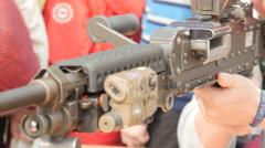 A man touches a machine gun Stock Footage