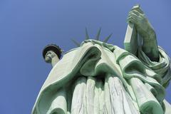 Looking up at Lady Liberty holding torch and tablet Stock Photos