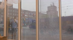 Cityscape Reflection in Showcase Dull Rainy Day People Are Standing Cars Are Stock Footage