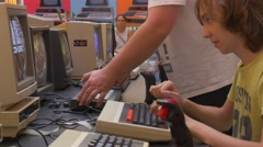The Young Guy Prints the Text on the Old Keyboard During Carrying Out of Stock Footage